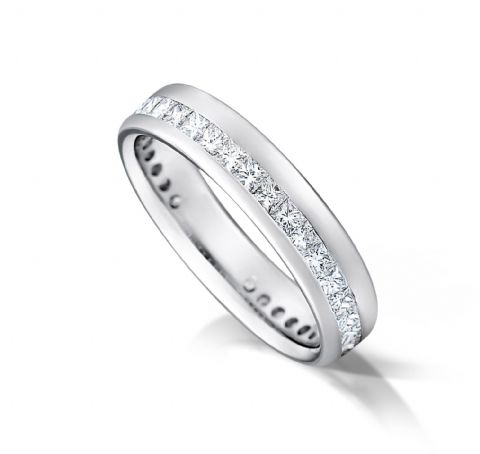 Channel off set eternity/wedding ring, platinum. 4mm x 1.7mm. 1/2 coverage